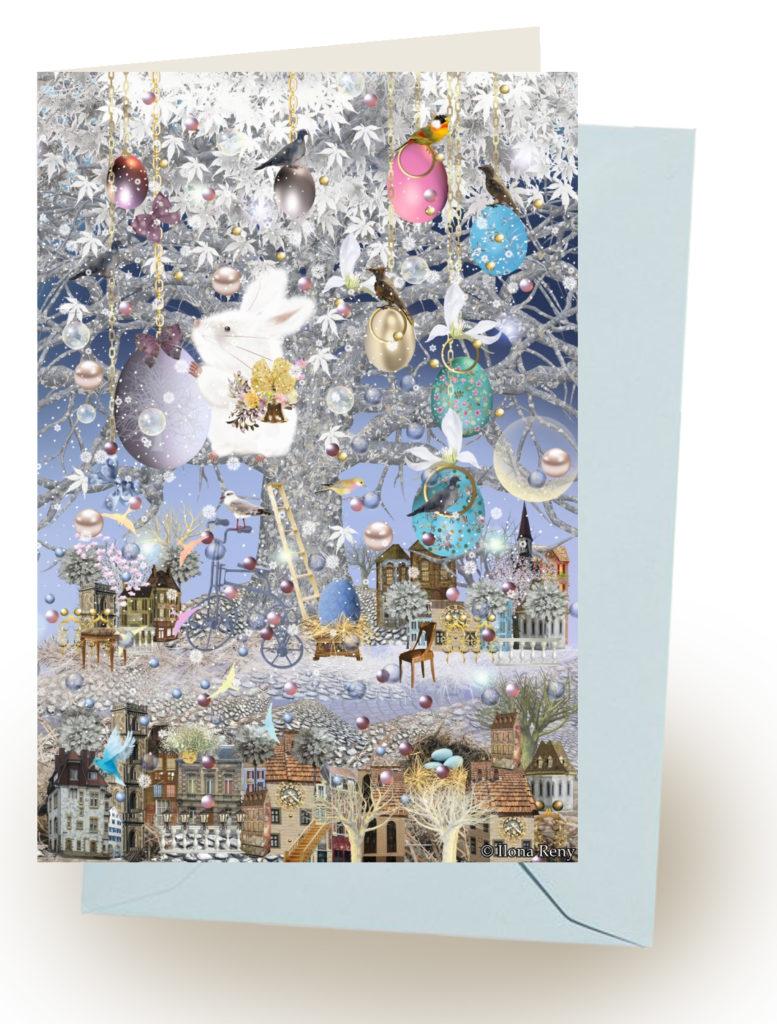 Grußkarte Ostern mit hellblauem Umschlag von Ilona Reny: weißer Osterhase hängt Eier im Baum auf