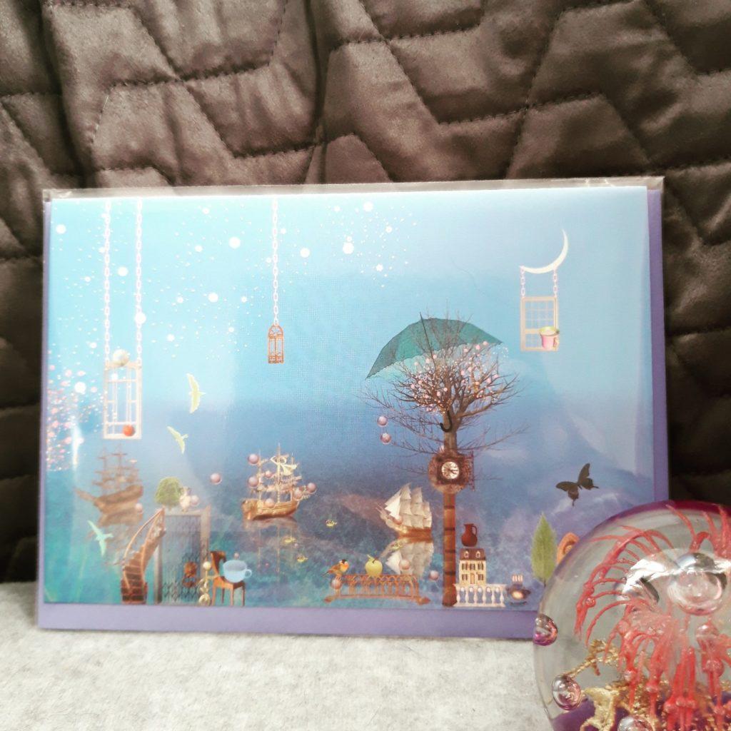 Grußkarten Ilona Reny: Blauer Himmel, blaues Meer, Bäume und Schiffe